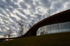 Dramatic sky over Grace Farm's Auditorium