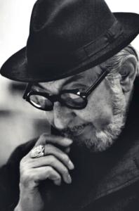 Carlo Scarpa wearing a hat